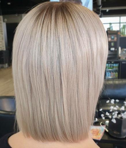 Hiukset leikattu polkkamalliin